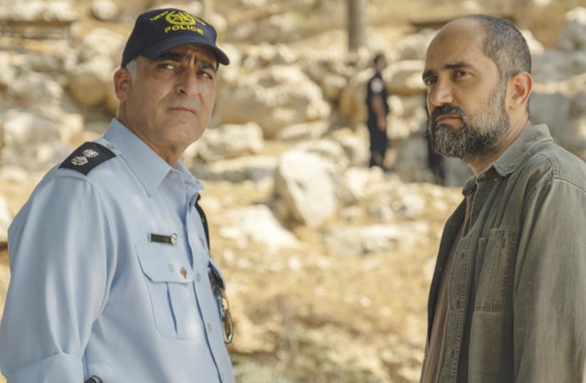 YORAM TOLEDANO (left) and Shlomi Elkabetz in 'Our Boys.' (photo credit: HBO)