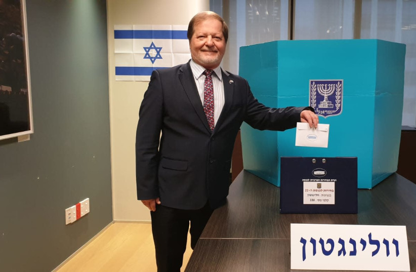 Israeli Ambassador to New Zealand, Dr. Itzhak Greenberg, casts the first vote in the Israeli Elections on Thursday morning in the Israeli embassy in Wellington (photo credit: MFA)