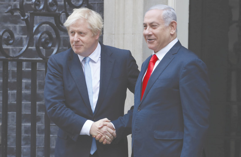 BRITAIN'S PRIME Minister Boris Johnson welcomes Prime Minister Benjamin Netanyahu to Downing Street in London, yesterday. (photo credit: SIMON DAWSON/ REUTERS)