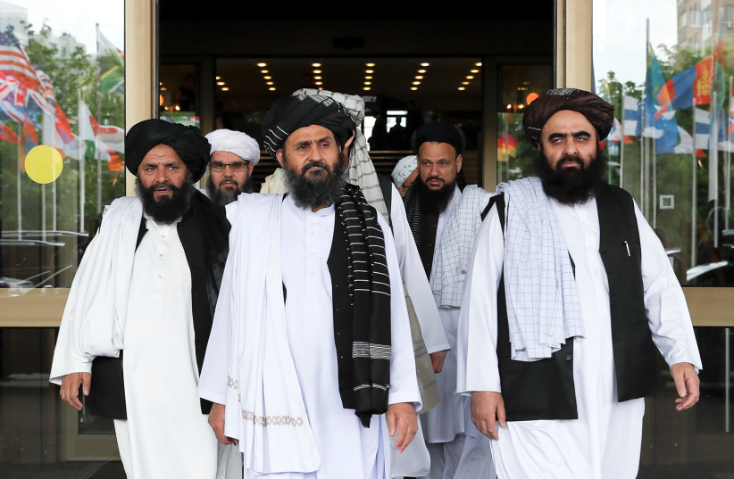 Members of a Taliban delegation leave after peace talks with Afghan senior politicians in Moscow, May 30, 2019 (photo credit: EVGENIA NOVOZHENINA/REUTERS)