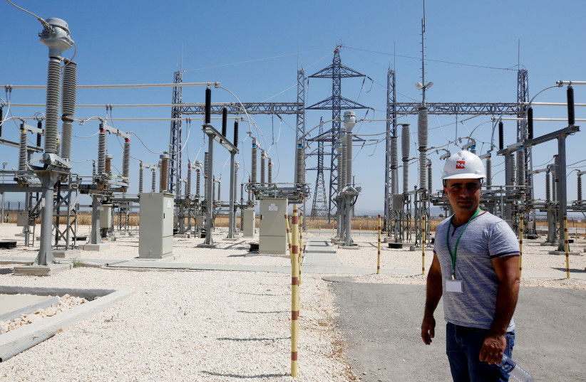 Israeli engineer stands in the new electrical substation near the West Bank city of Jenin (photo credit: ABED OMAR QUSINI/REUTERS)