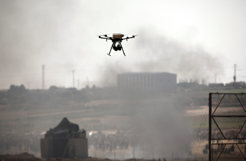 A drone is seen over the border between Israel and Gaza in June (photo credit: AMIR COHEN/REUTERS)