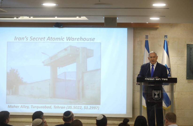 Prime Minister Benjamin Netanyahu reveals the Iranian nuclear bases uncovered by Israel.  (photo credit: MARC ISRAEL SELLEM)