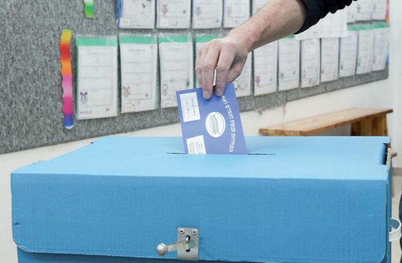 A voter in Jerusalem in the last Knesset election on April 9 (photo credit: MARC ISRAEL SELLEM)