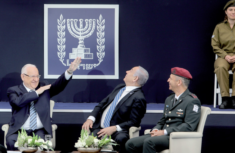 President Reuven Rivlin hosts Prime Minister Benjamin Netanyahu and IDF Chief of Staff Lt.-Gen. Aviv Kochavi during a ceremony honoring outstanding soldiers in the IDF at the President's Residence in Jerusalem on May 9 (photo credit: MARC ISRAEL SELLEM)