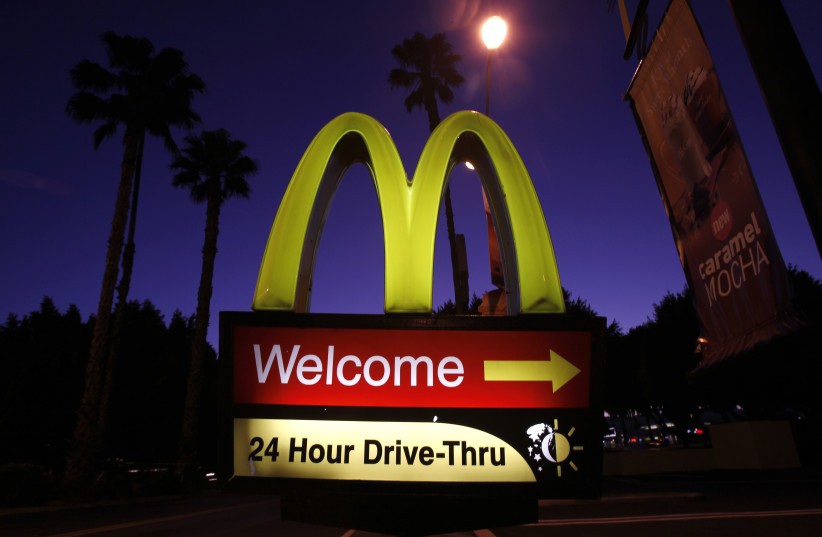 A McDonald's restaurant's drive-thru sign is pictured in Los Angeles April 4, 2011. Fast-food chain McDonald's Corp, trying to grab positive headlines in an economic recovery still struggling to create living-wage jobs, announced on Monday that it would do all of its spring hiring in one fell swoop. (photo credit: MARIO ANZUONI/REUTERS)