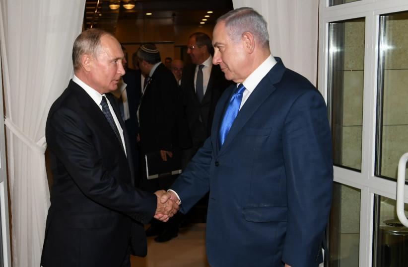 Prime Minister Benjamin Netanyahu says farewell to Russian President Vladimir Putin  (photo credit: AMOS BEN-GERSHOM/GPO)