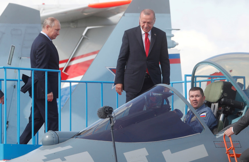 Russian President Vladimir Putin and Turkish President Recep Tayyip Erdogan inspect Sukhoi Su-57 fifth-generation fighter during the MAKS-2019 International Aviation and Space Salon in Zhukovsky outside Moscow, Russia, August 27, 2019. (photo credit: MAXIM SHIPENKOV/POOL VIA REUTERS/FILE PHOTO)