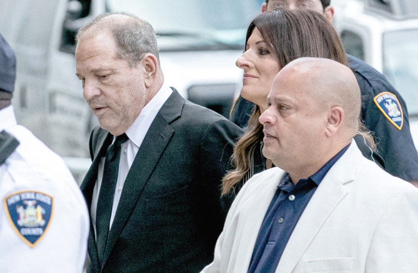 FILM PRODUCER Harvey Weinstein (left) arrives at New York Supreme Court for the arraignment in his sexual assault case in August. (photo credit: JEENAH MOON/REUTERS)