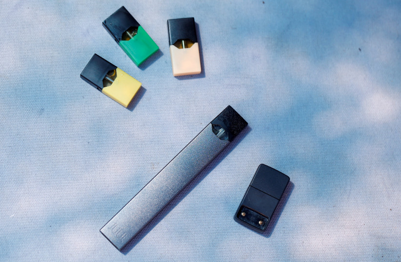 A Juul e-cigarette and pods are seen in this picture illustration taken September 16, 2018 (photo credit: REUTERS/Ronen Zvulun)