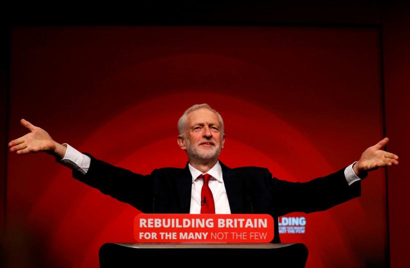 Britain's Labour Party leader Jeremy Corbyn delivers his keynote speech at the Labour Party Conference in Liverpool in 2018 (photo credit: PHIL NOBLE/REUTERS)