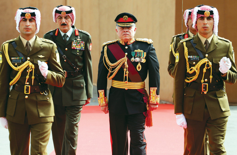 JORDAN'S KING Abdullah reviews the honour guard before the opening of the second ordinary session of 17th Session of Parliament in Amman IN 2014.  (photo credit: REUTERS)