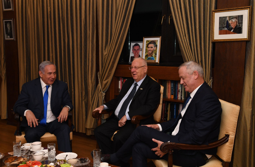 Prime Minister Benjamin Netanyahu, President Reuven Rivlin and Blue and White leader Benny Gantz meet after to discuss the formation of the new government, Setepmber 23 2019  (photo credit: CHAIM TZACH/GPO)