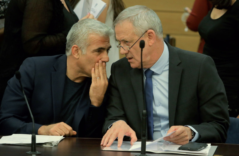 Blue and White leaders Benny Gantz and Yair Lapid confer at a party meeting (photo credit: MARC ISRAEL SELLEM)