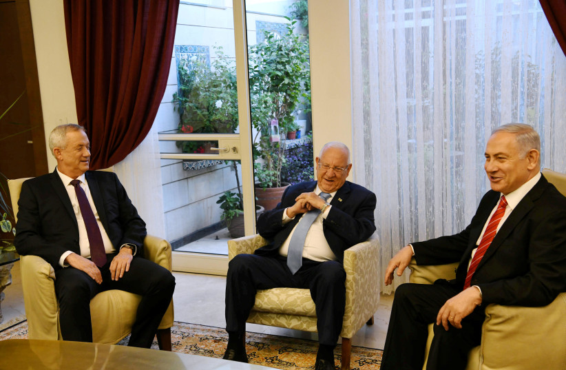 President Reuven Rivlin (center) meets with Prime Minister Benjamin Netanyahu (right) and Blue and White leader Benny Gantz, September 25 2019  (photo credit: AMOS BEN GERSHOM, GPO)