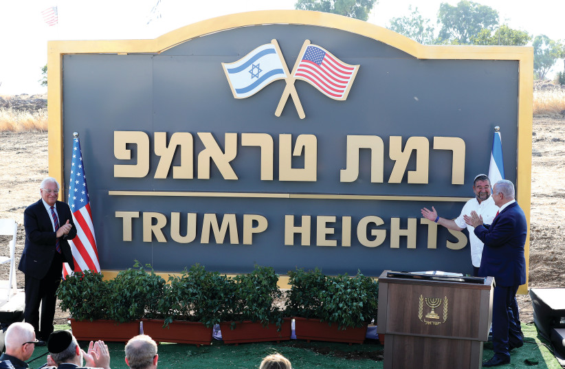 PRIME MINISTER Benjamin Netanyahu and US Ambassador David Friedman attend a ceremony to unveil a sign for a new Golan Heights community named after US President Donald Trump, in June. (photo credit: AMMAR AWAD / REUTERS)