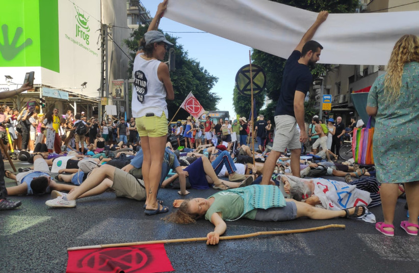 Thousands protest climate change in the streets of Tel Aviv. (photo credit: XR ISRAEL)