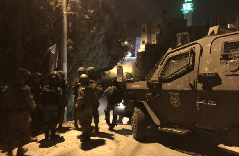IDF soldiers preparing for a raid in Kfar Ni'ma, near Modiin (photo credit: ANNA AHRONHEIM)