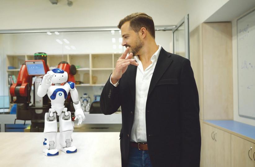 AI ROBOT Nao teaches 'TechTalk' host and executive producer Jonny Caplan how to do Tai Chi in the Curios Robots Lab at Tel Aviv University (photo credit: Courtesy)