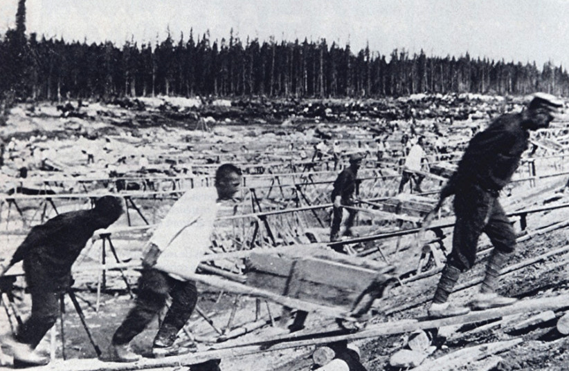 PRISONERS LABOR at the site of Belomorkanal, the man-made channel connecting the White Sea and Baltic Sea that was constructed by Soviet Gulag inmates. Tzvi Netzer served a full year in the infamous Siberian Gulag. (photo credit: Wikimedia Commons)