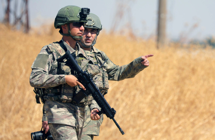 Turkish soldiers walk together during a joint U.S.-Turkey patrol, near Tel Abyad, Syria (photo credit: REUTERS/RODI SAID)