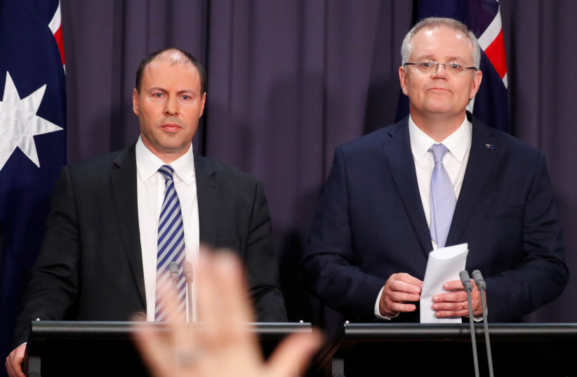 The new Australian Prime Minister Scott Morrison and his deputy Josh Frydenberg hold a news conference in Canberra, Australia August 24, 2018.  (photo credit: REUTERS/DAVID GRAY/FILE PHOTO)