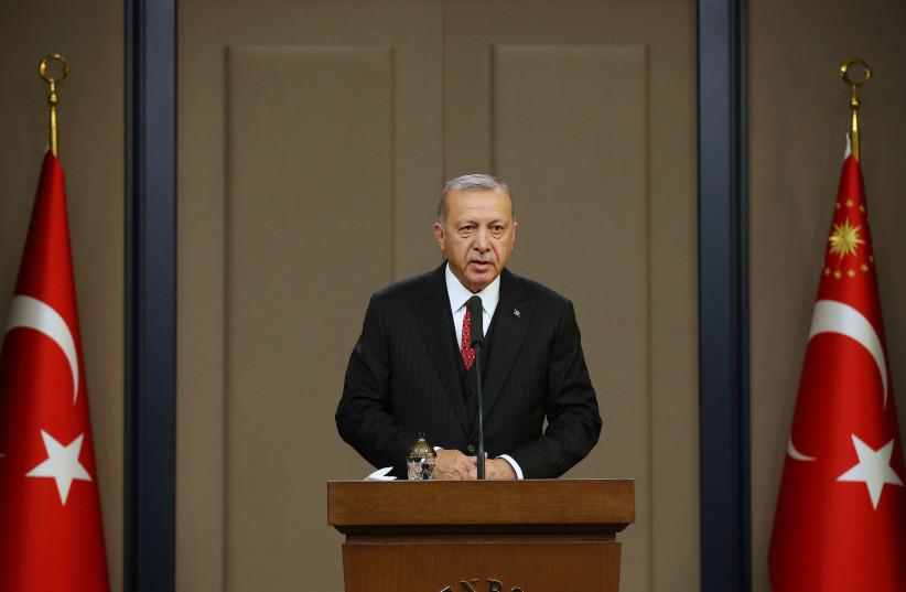 Turkish President Tayyip Erdogan speaks at Esenboga Airport in Ankara, Turkey, October 7, 2019 (photo credit: REUTERS)