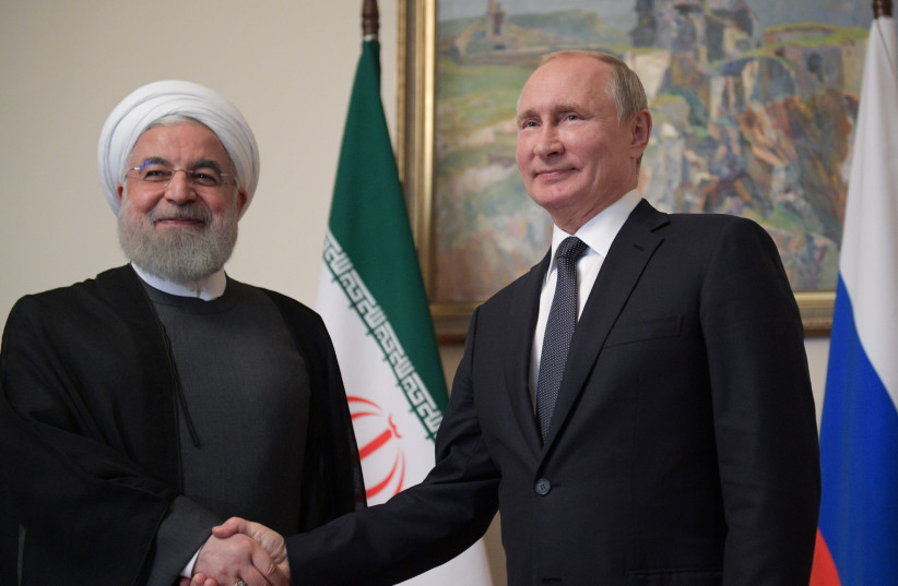Russian President Vladimir Putin shakes hands with Iranian President Hassan Rouhani during a meeting on the sidelines of a session of the Supreme Eurasian Economic Council In Yerevan, Armenia October 1, 2019 (photo credit: REUTERS)
