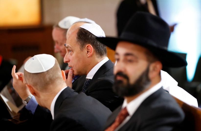 Men wearing kippah are pictured before a ceremony to mark the 80th anniversary of Kristallnacht, also known as the Night of Broken Glass, at Rykestrasse Synagogue, in Berlin, Germany, November 9, 2018 (photo credit: REUTERS/FABRIZIO BENSCH)
