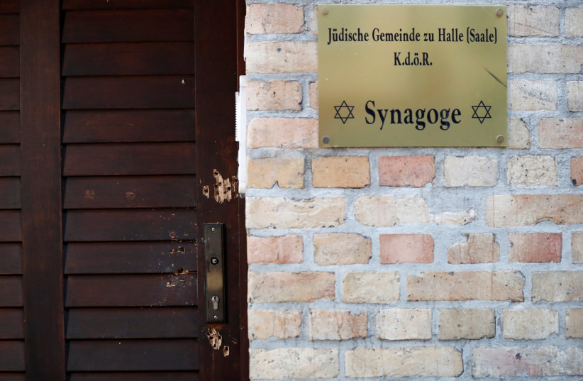 The damaged door of a synagogue is seen in Halle, Germany October 10, 2019, after two people were killed in a shooting (photo credit: REUTERS/FABRIZIO BENSCH)