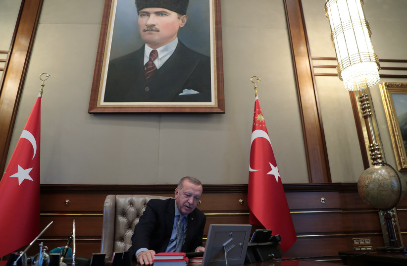 Turkish President Tayyip Erdogan speaks to Defence Minister Hulusi Akar on the phone at the Presidential Palace in Ankara, Turkey, October 9, 2019 (photo credit: REUTERS)