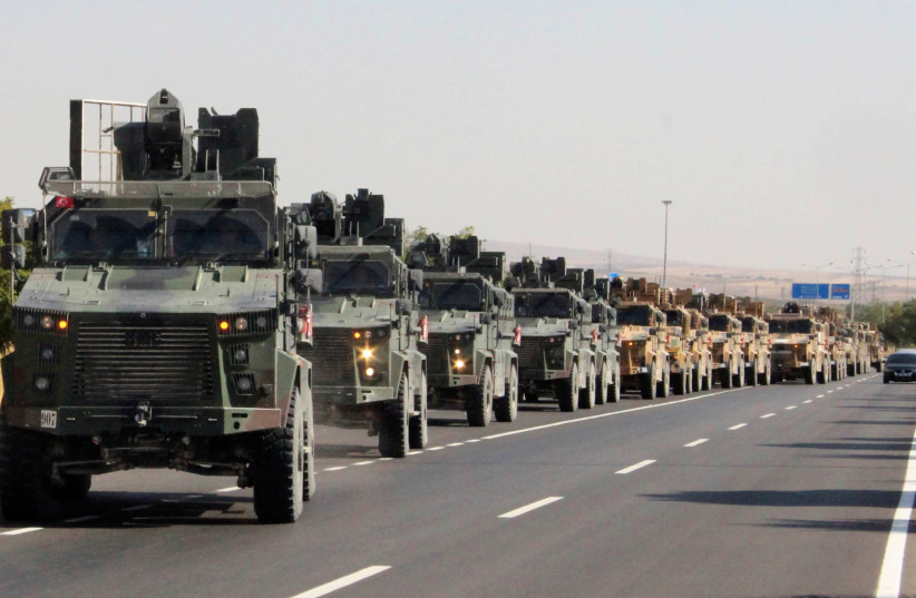 A Turkish miltary convoy is pictured in Kilis near the Turkish-Syrian border, Turkey, October 9, 2019 (photo credit: REUTERS)