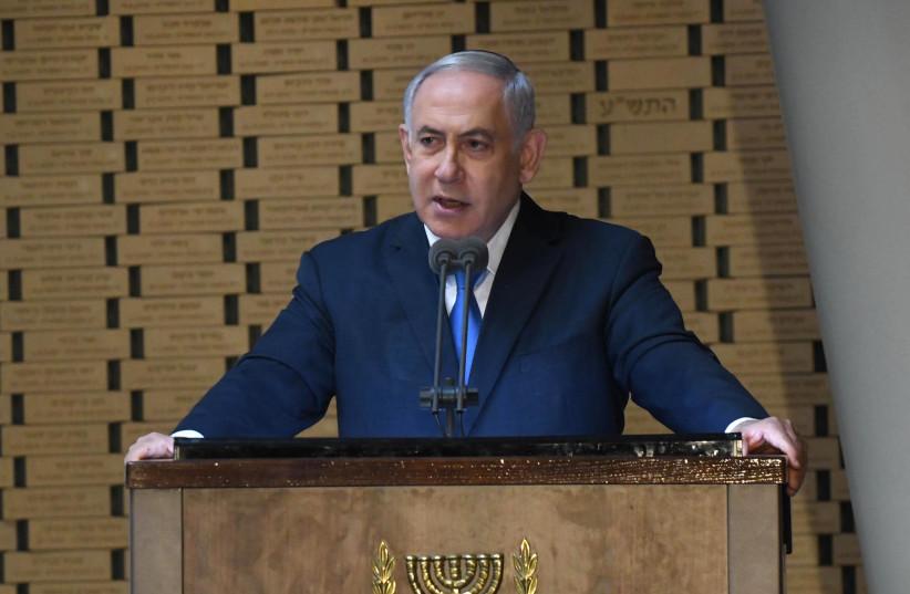 Prime Minister Benjamin Netanyahu speaks at the Memorial Service for the Victims of the Yom Kippur War at the Herzl Memorial Hall in Jerusalem, October 10 2019 (photo credit: GPO/AMOS BEN GERSHOM)