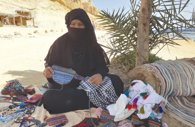 A BEDOUIN woman displays some of her wares (photo credit: GIL ZOHAR)