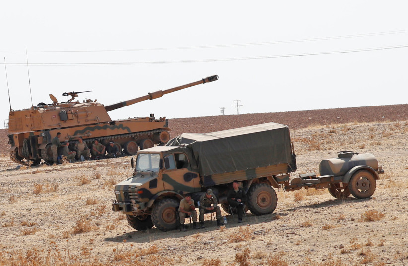 Turkish army vehicles and military personnel are stationed near the Turkish-Syrian border in Sanliurfa province, Turkey, October 12, 2019 (photo credit: MURAD SEZER/REUTERS)