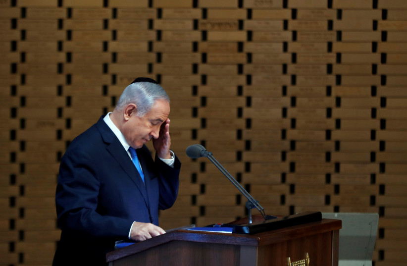 Israeli Prime Minister Benjamin Netanyahu gestures as he speaks during a memorial ceremony for Israeli soldiers killed in the 1973 Middle East War at Mount Herzl Military Cemetery in Jerusalem October 10, 2019 (photo credit: REUTERS/Ronen Zvulun)