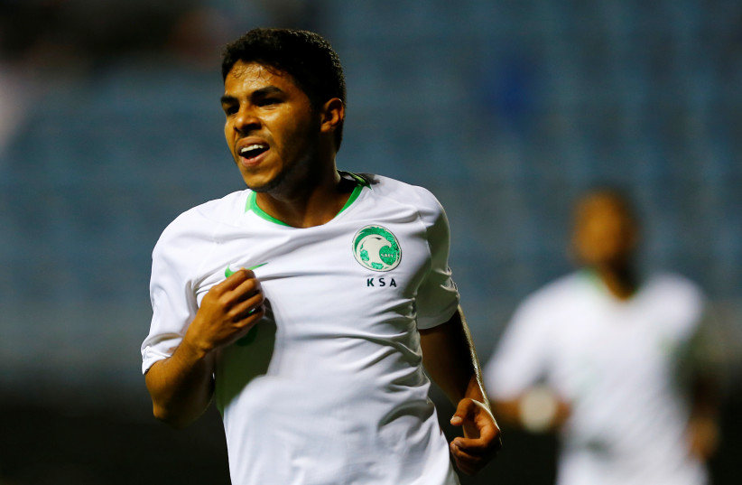 Saudi Arabia's Yahya Al-Shehri celebrates scoring a goal in this 2018 picture  (photo credit: MARCELO DEL POZO/REUTERS)