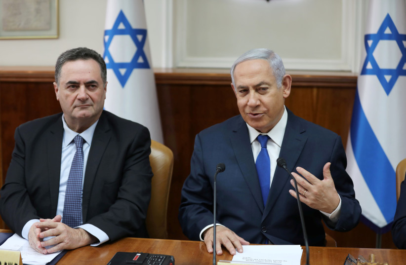 Israeli Prime Minister Benjamin Netanyahu sits next to foreign minister Israel Katz during a cabinet meeting (photo credit: REUTERS)