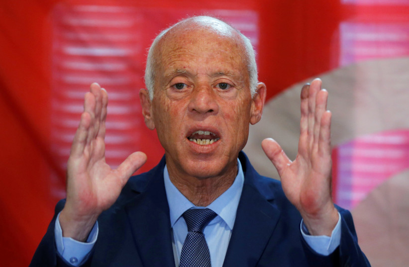 Presidential candidate Kais Saied speaks during a news conference after the announcement of the results in the first round of Tunisia's presidential election (photo credit: MUHAMMAD HAMED/REUTERS)