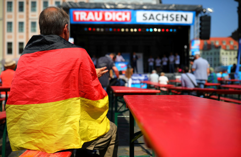 Supporters attend an election campaign of Germany's far-right Alternative For Germany (AFD) party ahead of Saxony state elections in Dresden, Germany, August 25, 2019. (photo credit: HANNIBAL HANSCHKE/REUTERS)