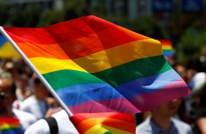 The rainbow flag, commonly known as the gay pride flag or LGBT pride flag, is seen during the first Gay Pride parade in Skopje, North Macedonia June 29, 2019 (photo credit: REUTERS/OGNEN TEOFILOVSKI)