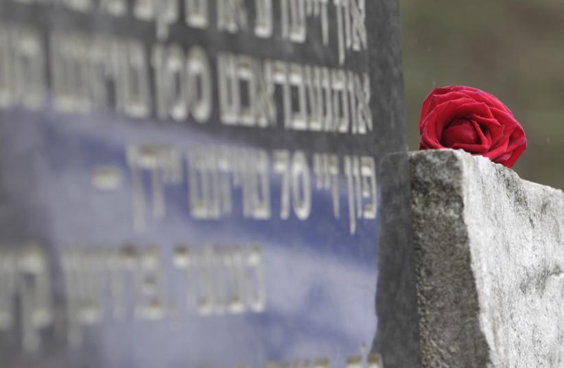 A monument honoring the victims of the Ponary massacre near Vilnius, Lithuania (photo credit: INTS KALNINS / REUTERS)