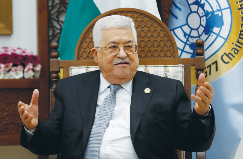 PA PRESIDENT Mahmoud Abbas – 'He makes threats and engages in fiery rhetoric as part of a strategy to appease the Palestinian public.' (photo credit: REUTERS/MOHAMAD TOROKMAN)
