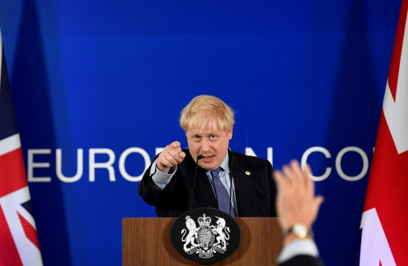 Britain's Prime Minister Boris Johnson takes questions during a news conference at the European Union leaders summit dominated by Brexit, in Brussels, Belgium October 17, 2019 (photo credit: REUTERS/TOBY MELVILLE)