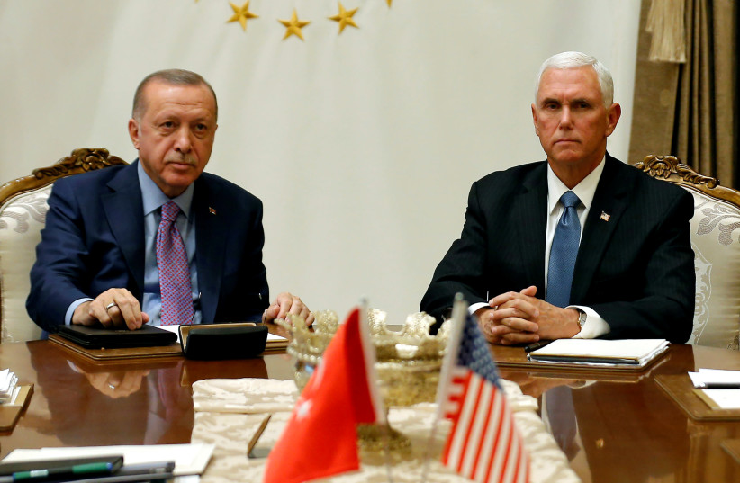 U.S. Vice President Mike Pence meets with Turkish President Tayyip Erdogan at the Presidential Palace in Ankara, Turkey, October 17, 2019 (photo credit: REUTERS/HUSEYIN ALDEMIR/FILE PHOTO)