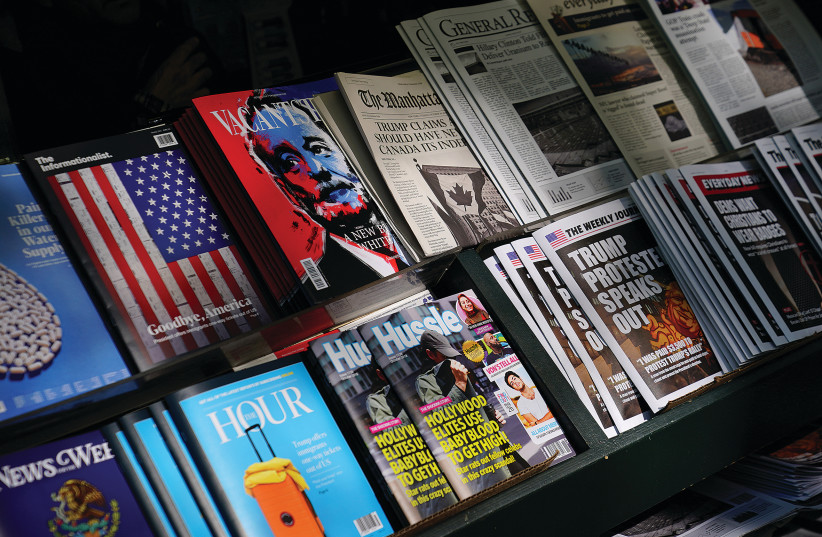 A newsstand in Manhattan outfitted with 'Fake News' headlines was a stunt by the 'Columbia Journalism Review,' in October 2018. (photo credit: CARLO ALLEGRI/REUTERS)