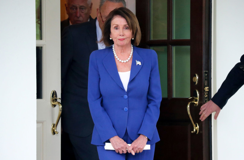 U.S. House Speaker Nancy Pelosi (D-CA) walks out with Senate Minority Leader Chuck Schumer (D-NY) and House Majority Leader Steny Hoyer (D-MD) to speak with reporters after meeting with President Trump at the White House in Washington, U.S. October 16, 2019 (photo credit: REUTERS/JONATHAN ERNST)