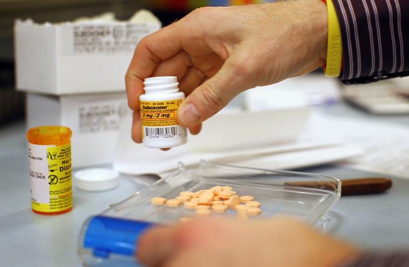 Pharmacist Jim Pearce fills a Suboxone prescription at Boston Healthcare for the Homeless Program in Boston (photo credit: REUTERS)