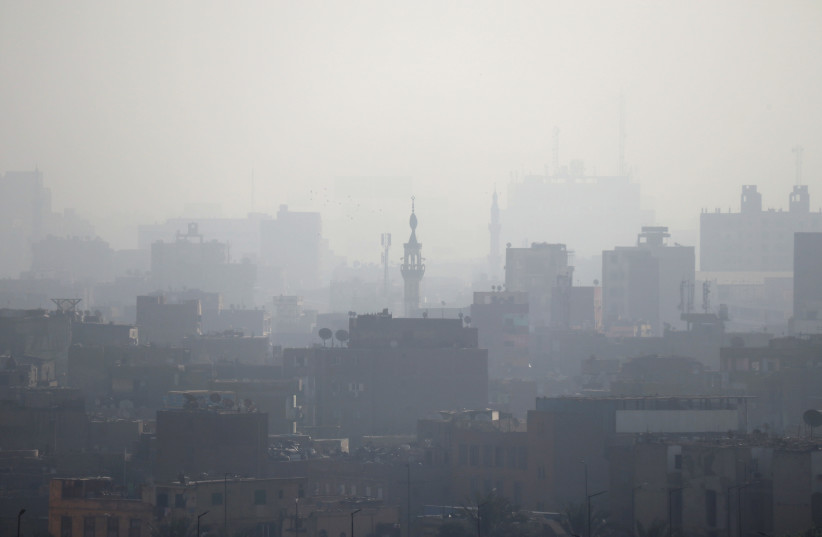 A minaret is seen through early morning haze on the skyline of Cairo, Egypt March 21, 2018 (photo credit: REUTERS/RUSSELL BOYCE)