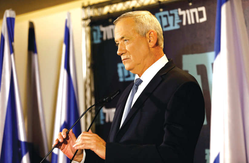 BENNY GANTZ : His government would only have to last until Netanyahu is indicted (photo credit: REUTERS)